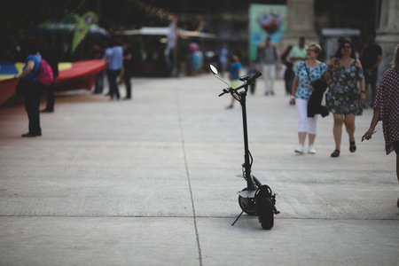 Shallow depth of field image with a parked electrical scooter in downtown Bucharest Editorial