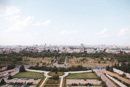 Cityscape of old part of Bucharest, with Izvor Park in the foreground, with many worn out buildings, as seen from the Palace of Parliament Archivio Fotografico - 129469840