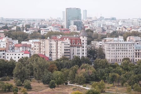 Cityscape of old part of Bucharest, with many worn out buildings, as seen from the Palace of Parliament Archivio Fotografico - 129469838