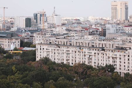 Cityscape of old part of Bucharest, with many worn out buildings, as seen from the Palace of Parliament Archivio Fotografico - 129469847