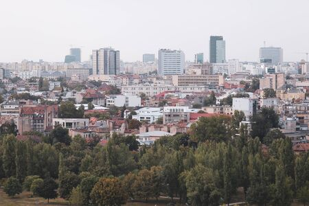 Cityscape of old part of Bucharest, with many worn out buildings, as seen from the Palace of Parliament Archivio Fotografico - 129469848