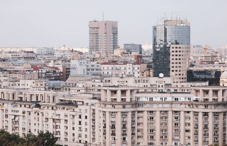 Cityscape of old part of Bucharest, with many worn out buildings, as seen from the Palace of Parliament Archivio Fotografico - 129469849