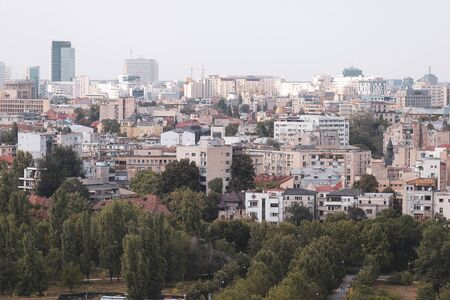 Cityscape of old part of Bucharest, with many worn out buildings, as seen from the Palace of Parliament