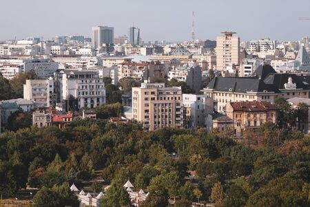 Cityscape of old part of Bucharest, with many worn out buildings, as seen from the Palace of Parliament Archivio Fotografico - 129469851