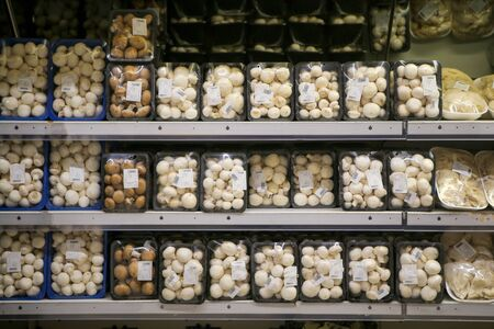 Bucharest, Romania - August 27, 2019: Fresh mushrooms on the fruits and vegetables aisle in a store. Stock fotó