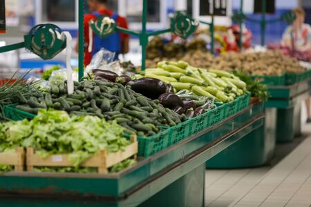 Eggplants and zucchini on the fruits and vegetables aisle in a store