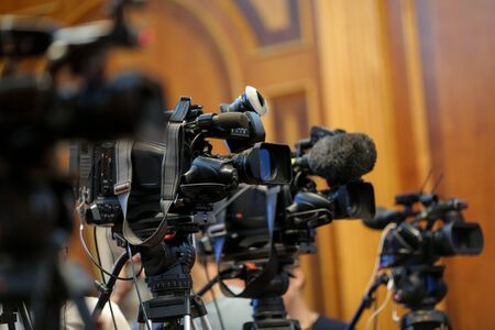 Details with television video cameras and recording equipment during a press event