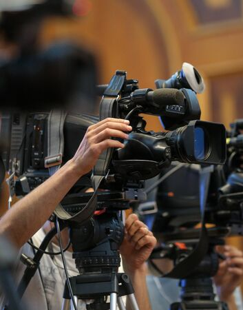 Details with television video cameras and recording equipment during a press event Standard-Bild - 129568394