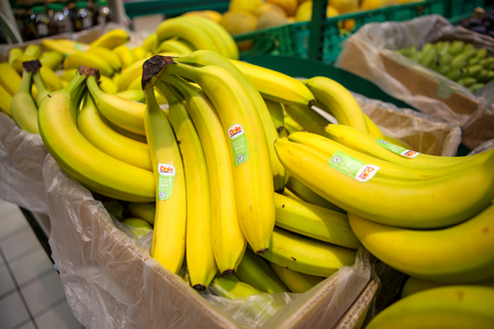 Bucharest, Romania - August 27, 2019: Dole bananas on the fruits and vegetables aisle in a store.