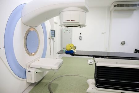 Human tissue mimicking mannequin head on a medical linear accelerator (LINAC) used for radiation therapy for cancer patients Stock fotó