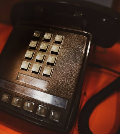 Details with an old school, retrovintage style telephone.
