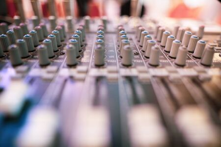 Shallow depth of field (selective focus) image with the controls on an audio mixer Stock Photo