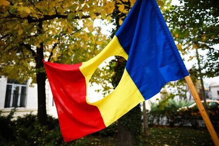 Details with the Romanian flag with a hole, the symbol of the Romanian Revolution from December 1989 when the communist emblem was cut out from the flag.