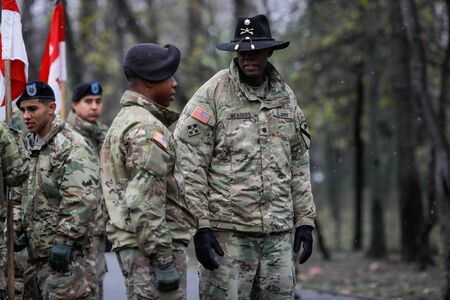 Bucharest, Romania - December 01, 2019: US Army soldiers of the 1st Cavalry Division take part at the Romanian National Day military parade. Editorial