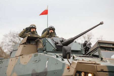 BUCHAREST, ROMANIA - December 1, 2019: Polish soldiers in a ROSOMAK armored vehicle at the Romanian National Day military parade. Editorial