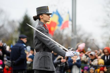 Bucharest, Romania - December 01, 2019: Female soldier World War I reenactor take part at the Romanian National Day military parade.