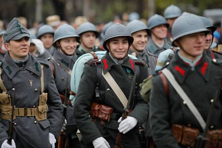 Bucharest, Romania - December 01, 2019: World War I reenactors with their equipment take part at the Romanian National Day military parade.