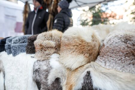 Fur hats and other animals furs on exhibition at a peasants fair in Bucharest, Romania.