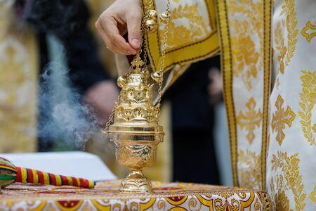 Details with a golden metallic christian orthodox frankincense burner, or censer.