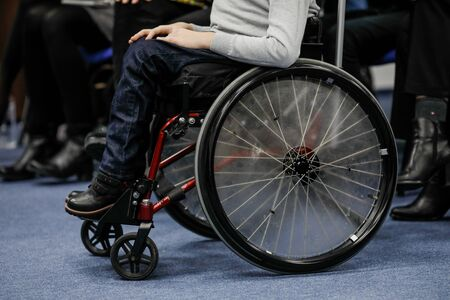 Details of an ill disabled young boy in a wheelchair. Imagens