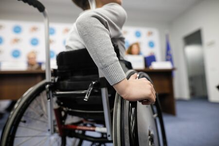 Details of an ill disabled young boy in a wheelchair. Stock Photo