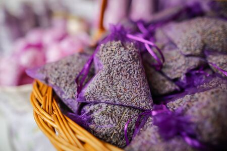 Shallow depth of field (selective focus) image with lavender in bags on sale in a traditional Romanian market.