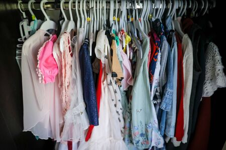 Shallow depth of field (selective focus) image with the wardrobe of a small girl. Children's clothing. Standard-Bild