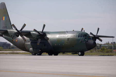 Otopeni, Romania - April 25, 2020: Lockheed C-130 Hercules military cargo plane of the Romanian Air Force.