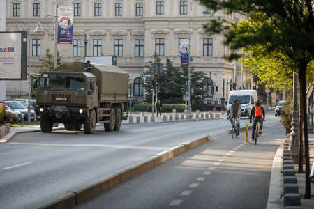 Bucharest, Romania - April 22, 2020: Romanian army truck in downtown Bucharest during the covid-19 lockdown.