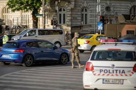 Bucharest, Romania - April 22, 2020: Romanian army and police enforce the covid-19 lockdown in Bucharest.