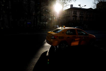 Bucharest, Romania - April 22, 2020: Taxi car in Bucharest during the covid-19 lockdown.