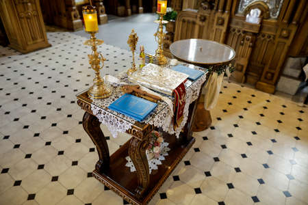 Bucharest, Romania - May 24, 2020: Details with accessories in an Orthodox Church needed for an Orthodox baptism. Baptismal font.