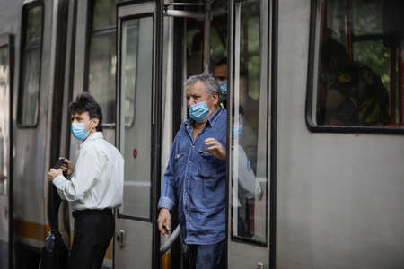 Bucharest / Romania - July 14, 2020: Tram in Bucharest with people wearing masks during the Covid-19 outbreak. Editorial