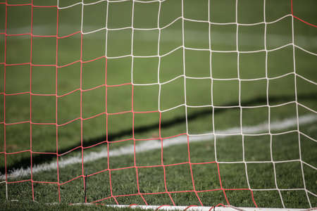 Shallow depth of field (selective focus) with the net of a soccer gate.