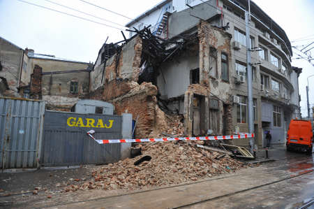 Bucharest, Romania - April 6, 2010: Remains of a collapsed old building on a street of Bucharest. 報道画像