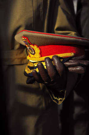 Details with the hands of a Romanian military officer holding his hat with his hands in leather gloves. Standard-Bild