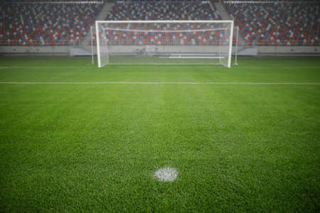 Shallow depth of field (selective focus) image with the penalty kick point on an empty soccer stadium. 免版税图像