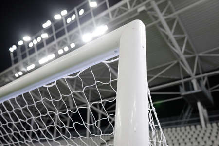 Shallow depth of field (selective focus) image  with the top corner of a soccer gate.