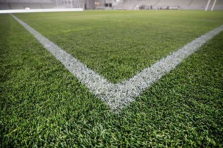 Shallow depth of field (selective focus) image with the corner point of a soccer field.