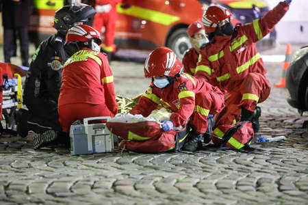 Bucharest, Romania - December 5, 2020: Paramedics from the Romanian Ambulance (SMURD) exercise the rescue of a car crash victim. 新闻类图片