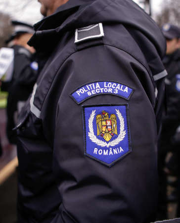 Bucharest, Romania - November 22, 2016: Details with the emblem of Bucharest Local Police (Politia Locala sector 3) on the uniform of a police officer.