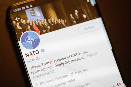 Bucharest, Romania - December 13, 2020: Details with the Twitter account of NATO on a mobile device screen. 新闻类图片