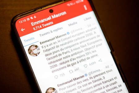 Bucharest, Romania - December 13, 2020: Details with the Twitter account of Emmanuel Macron on a mobile device screen.
