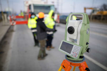 Shallow depth of field (selective focus) with a theodolite on a construction site.