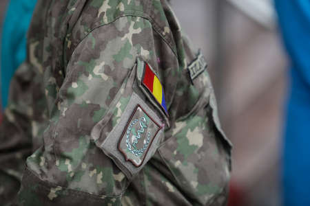 Bucharest, Romania - January 05, 2021:  Shallow depth of field (selective focus) image with the uniform and insignia of a Romanian army medic.