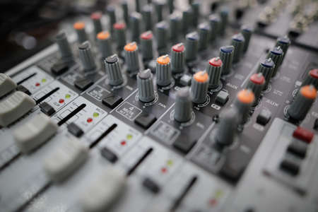 Shallow depth of field (selective focus) image with the controls on an audio mixer