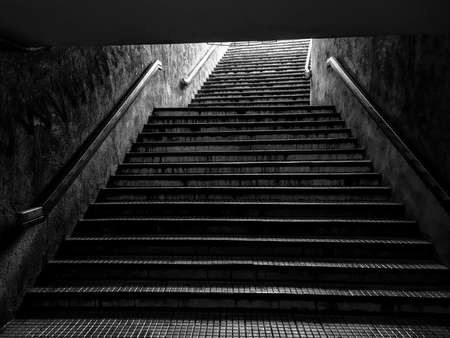 Grungy stairways at the entrance of a Bucharest subway station.