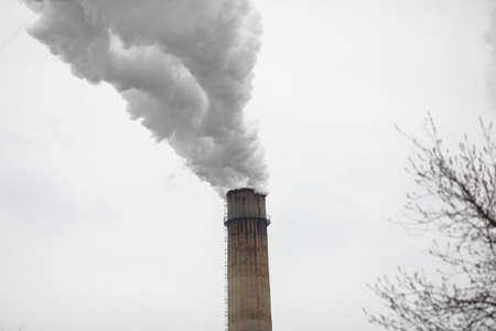 Chimney of a power station during a cold winter day in Bucharest.