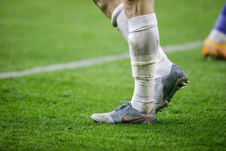 Bucharest, Romania - March 19, 2021: Details with Nike soccer shoes on a player during a game.