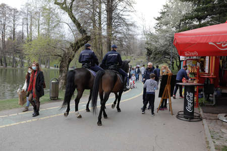 Bucharest, Romania - March 28, 2021: Romanian jandarmi on horses patrol the IOR park in Bucharest Editorial